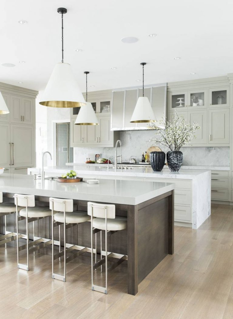Dark Kitchen Island and White Cabinets with Stools