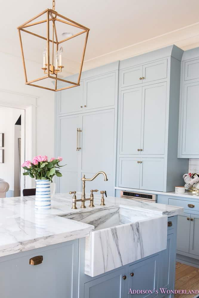 Soft Blue Kitchen Cabinet with Brass Touch